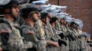 National Guard troops secure the police station in Ferguson, Missouri, on November 25, 2014. (FLICR Photo)