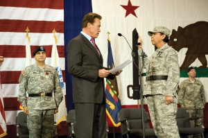 Gov. Arnold Schwarzenegger  swears Brig Gen. Mary Kight in as the 46th Adjutant General of the California  National Guard. Kight and her predecessor, Maj. Gen. William A. Wade (Left) restored confidence to a military culture and leadership that clashed with the cronyism interests of a power, internal, secret society. A society that would undermine both  their legacies, ascend to power, and launch the largest retaliation in CAL Guard history in the name of Governor's Mandate. (FLIICKR Photo)