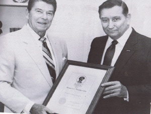 National Guard Association of California (NGAC) president Donald I. New presents President Ronald Reagan with the NGAC's Man-of-the-ear Award for 1983 at a special White House ceremony. New also presented the Commander-in-Chief an Honorary NGAC Membership. (File Photo)