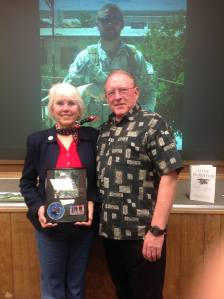 "Donna and Cecil Axelson accept a plaque of appreciation form the California Military History Foundation in remembrance of their son, Matt Axelson, one of three Navy Seals who died in Marcus Luttrel's book, ""One Survivor."" Matt Axelsen would have been the latest Californian enshrined at the California Military History Museum if not for Gov. Jerry Brown's mandate to close the museum. The State Military Department ordered all documentations of the visit destroyed in August 2014."